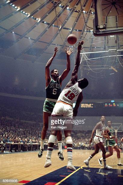 Bill Russell of the Boston Celtics shoots over Willis Reed of the New York Knicks circa 1965 at Madison Square Garden in New York New York NOTE TO...