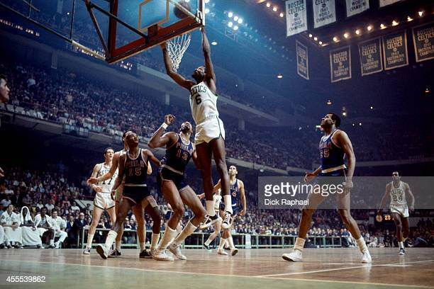 Bill Russell of the Boston Celtics shoots the ball against Wilt Chamberlain of the Philadelphia Warriors during a game circa 1959 at the Boston...