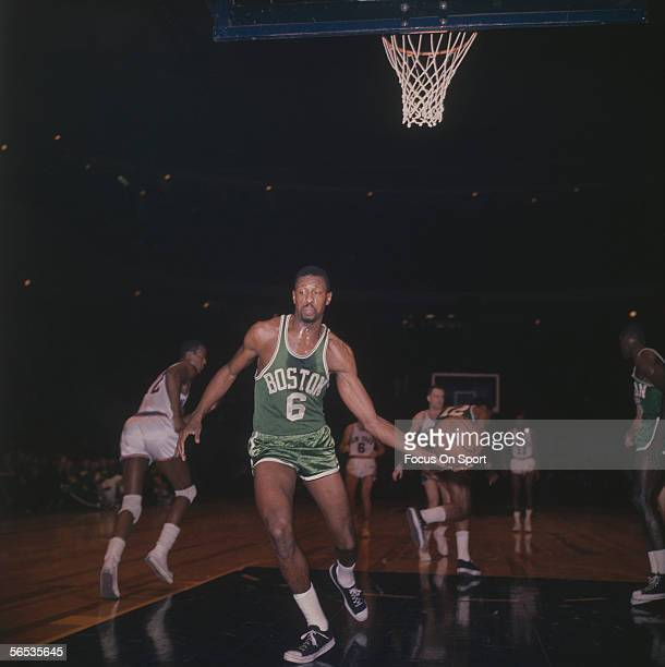 Bill Russell of the Boston Celtics takes the ball after a New York Knicks score circa the 1960's during a game