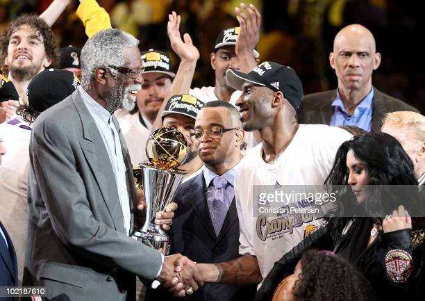Bill Russell presents the Bill Russell Finals MVP trophy to Kobe Bryant of the Los Angeles Lakers after the Lakers defeated the Boston Celtics in...