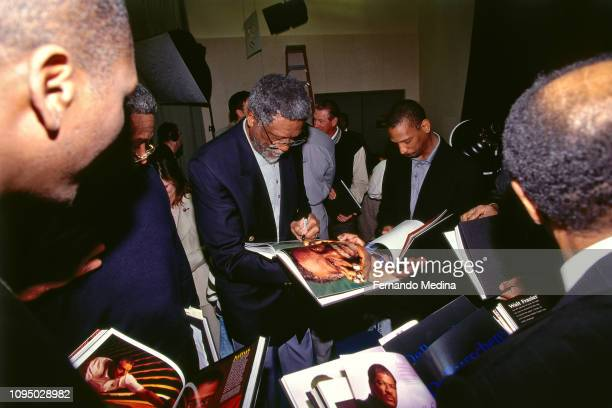 Bill Russell signs autographs for fans during the NBA at 50 Event on February 7 1997 as a part of NBA AllStar Weekend 1997 at the Gund Arena in...