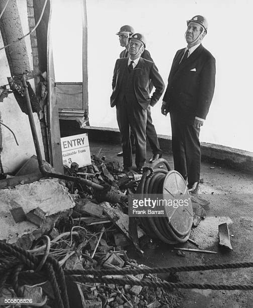 Bill Ryland and Edward Fennessy Managing Director of Telecommunications inspecting the damage caused by the bomb blast on the 31st floor of the Post...
