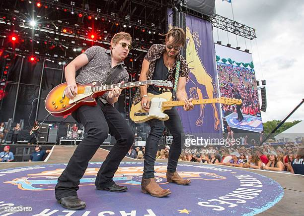 Bill Satcher and Zach Brown of A Thousand Horses performs during Faster Horses Festival at Michigan International Speedway on July 16 2016 in...