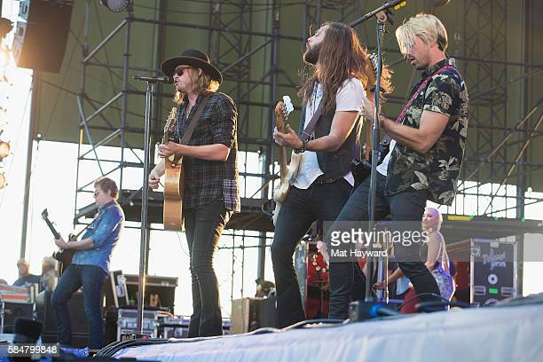 Bill Satcher Michael Hobby Graham DeLoach and Zach Brown of A Thousand Horses perform on stage during the Watershed Music Festival at Gorge...
