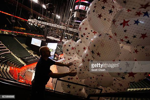 Bill Schaffell from Los Angeles California prepares balloons which will drop in the Xcel Energy Center on the final day of the Republican National...