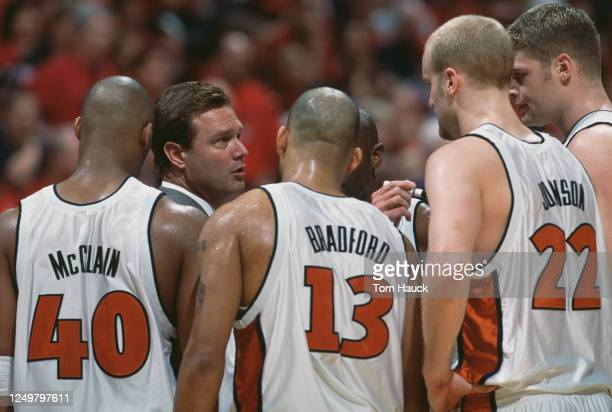 Bill Self, head coach for the Illinois Fighting Illini talks to his players Sergio McClain, #13 Cory Bradford and Lucas Johnson during the NCAA NCAA...