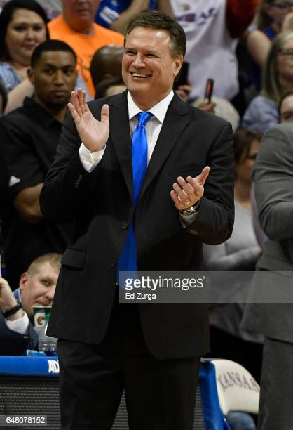 Bill Self head coach of the Kansas Jayhawks claps as he waits for Frank Mason III to leave a game against the Oklahoma Sooners in the second half at...