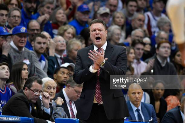 Bill Self head coach of the Kansas Jayhawks gives support to his team against the Oklahoma State Cowboys at Allen Fieldhouse on February 3 2018 in...