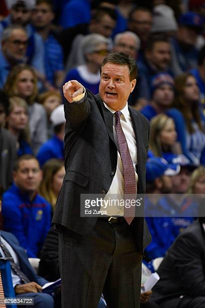 Bill Self head coach of the Kansas Jayhawks instructs his team against the Nebraska Cornhuskers at Allen Field House on December 10 2016 in Lawrence...