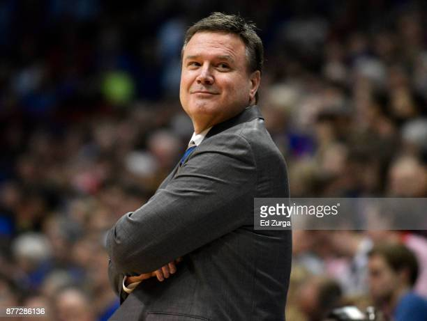 Bill Self head coach of the Kansas Jayhawks smiles as he watches his team play against the Texas Southern Tigers at Allen Fieldhouse on November 21...