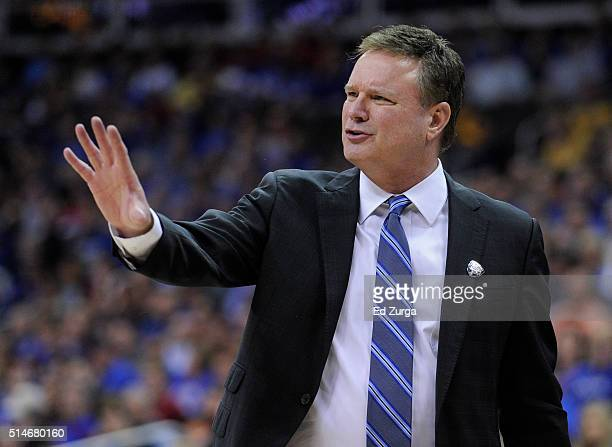 Bill Self head coach of the Kansas Jayhawks talks to his team during a break in the action against the Kansas State Wildcats in the second half...