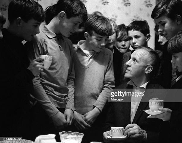 Bill Shankly had a cup of tea with children after he watched a game of street football from a flat above Eldon Grove off Liverpool's Scotland Road in...