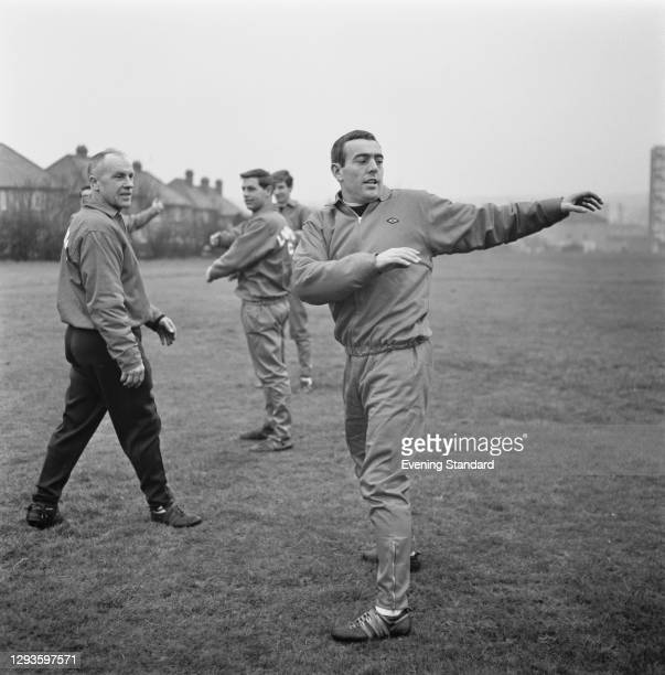 Bill Shankly , manager of Liverpool FC, watches team member Ian St John during a training session, UK, 27th January 1967.