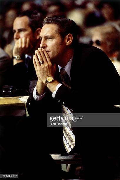 Bill Sharman head coach of the Los Angeles Lakers watches the action from the sidelines during a game against the Boston Celtics on February 11 1972...