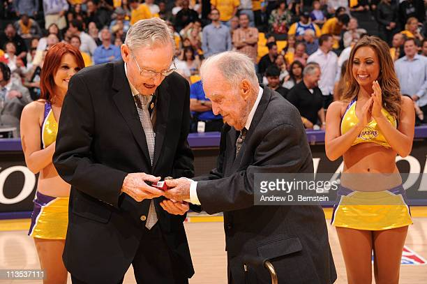 Bill Sharman is honored with a championship ring by American Basketball Association executive Dennis Murphy for coaching the Utah Stars to the 1971...