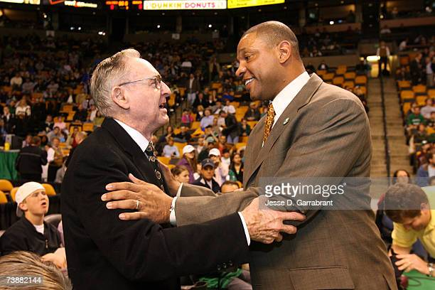 Bill Sharman of the 1957 Boston Celtics speaks with the head coach Doc Rivers prior to the game honoring the 50th anniversary of the 1957 NBA...