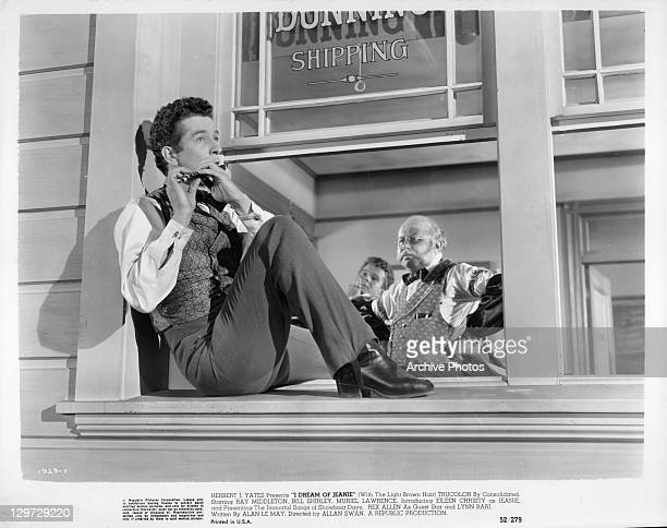 Bill Shirley plays the flute on the windowsill in a scene from the film 'I Dream Of Jeanie' 1952