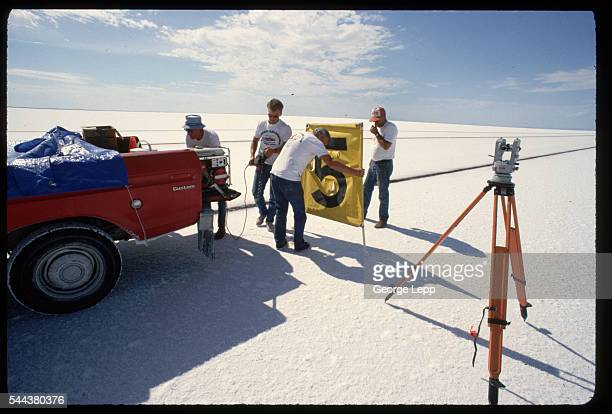 Bill Slattin Al Thayer Elmo Gillette and Tom Price place the marker for mile 5 in the salt at the Bonneville Salt Flats in Utah