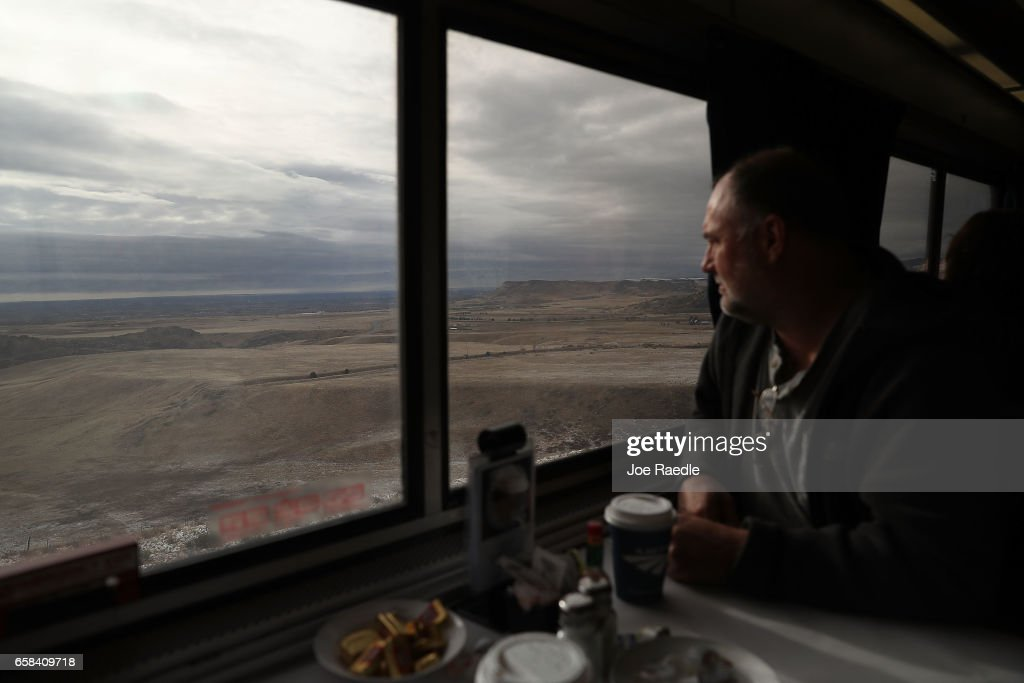 Bill Squier takes in the sights from the dining car on Amtrak's California Zephyr during its daily 2,438-mile trip to Emeryville/San Francisco from Chicago that takes roughly 52 hours on March 24, 2017 in Denver, United States. President Trump has proposed a national budget that would terminate federal support for Amtrak's long distance train services, which would affect the California Zephyr and other long distance rail lines run by Amtrak.