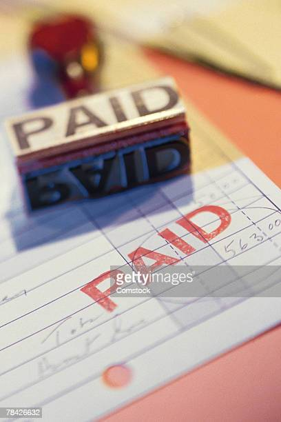 bill stamped paid - paid stock pictures, royalty-free photos & images