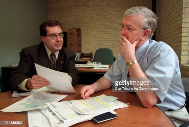Bill Stead the now departed project manager of the Hiawatha Bill Stead right and Edward Axt Jr left look over documents pertaining to the conflict of...