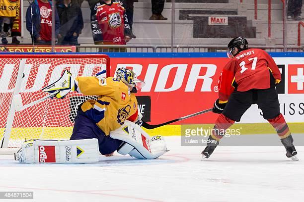 Bill Sweatt of Lulea Hockey scores the decisive goal past goaltender Rasmus Rinne of Lukko Rauma a penalty shot during the Champions Hockey League...