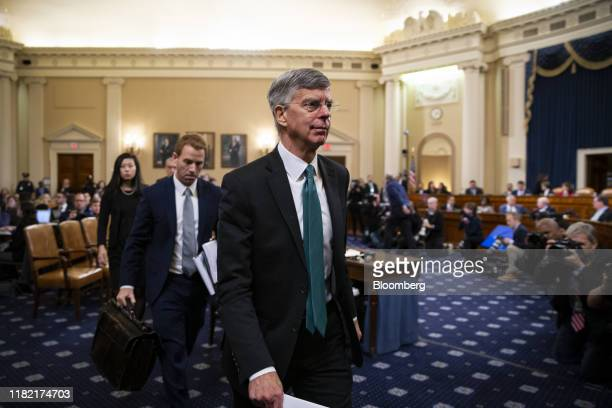 Bill Taylor acting US ambassador to Ukraine departs after testifying during a House Intelligence Committee impeachment inquiry hearing in Washington...