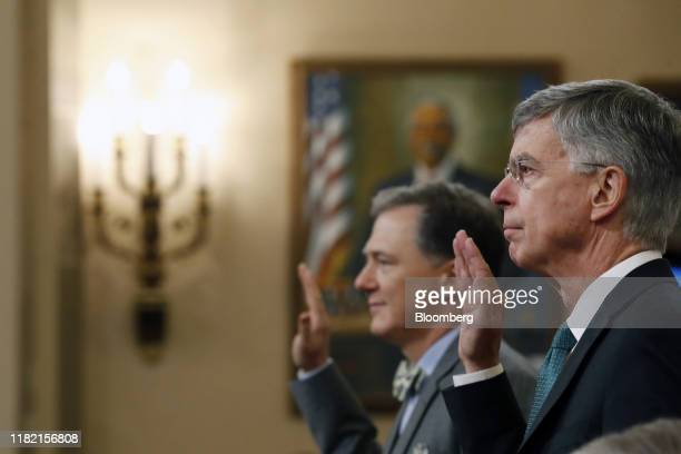 Bill Taylor acting US ambassador to Ukraine right and George Kent deputy assistant US secretary of state are sworn in during a House Intelligence...