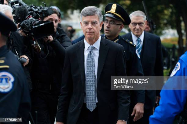 Bill Taylor center the acting US ambassador to Ukraine arrives to the Capitol for a deposition related to the House's impeachment inquiry on Tuesday...