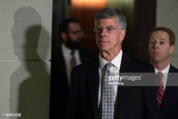 Bill Taylor the top US diplomat to Ukraine arrives at a closed session before the House Intelligence Foreign Affairs and Oversight committees October...