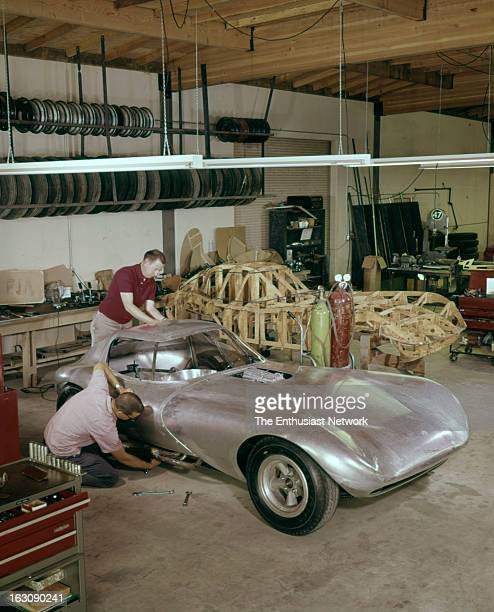 Bill Thomas Chevrolet Cheetah GT Race Car fabrication shop with wooden spar body buck in background and one of two aluminumbodied Cheetahs being...