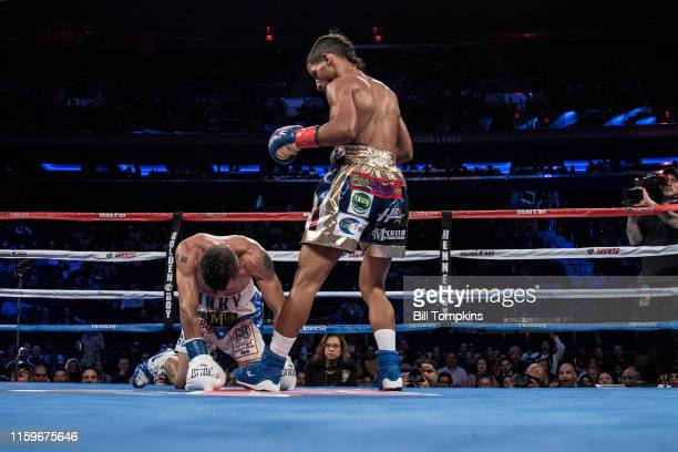 MANDATORY CREDIT Bill Tompkins/Getty Images Acosta knocks Alejo to the canvas Angel Acosta defeats Juan Alejo by Knock Out in the 10th round in their...