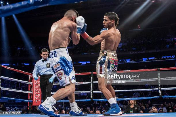MANDATORY CREDIT Bill Tompkins/Getty Images Acosta throws a left Angel Acosta defeats Juan Alejo by Knock Out in the 10th round in their...