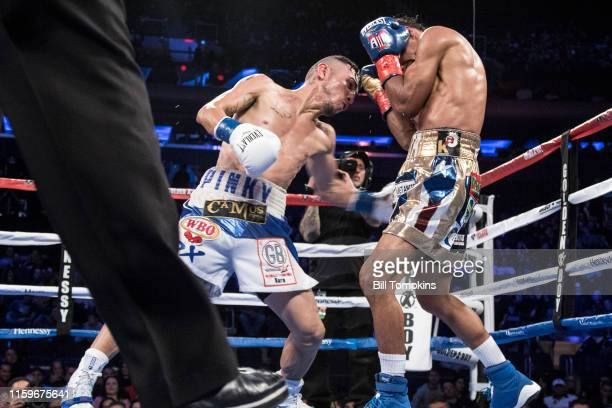 MANDATORY CREDIT Bill Tompkins/Getty Images Alejo throws a left body punch Angel Acosta defeats Juan Alejo by Knock Out in the 10th round in their...