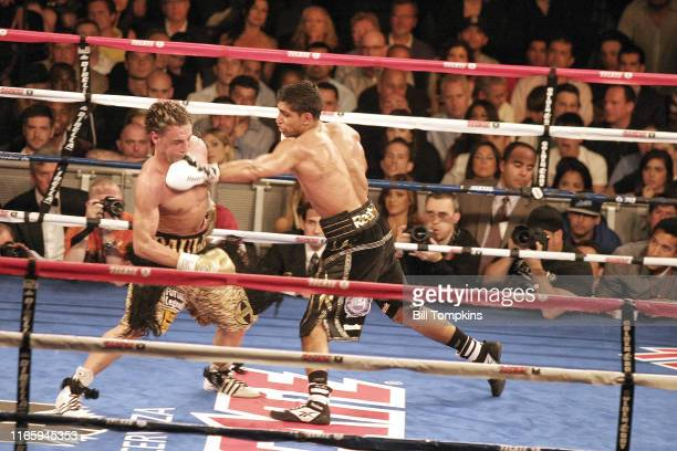 Bill Tompkins/Getty Images Amir Khan defeats Paul Malignaggi by TKO in the 11th round during their Super Lightweight fight at Madison Square Garden...