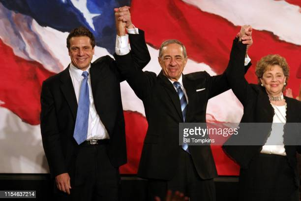 MANDATORY CREDIT Bill Tompkins/Getty Images Andrew Cuomo Mario Cuomo and Matilda Cuomo raise their hands in celebration during the Democratic Victory...