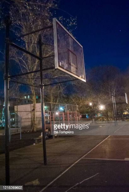 MANDATORY CREDIT Bill Tompkins/Getty Images Basketball rims removed to prevent people from gathering together to play basketball and from having rave...