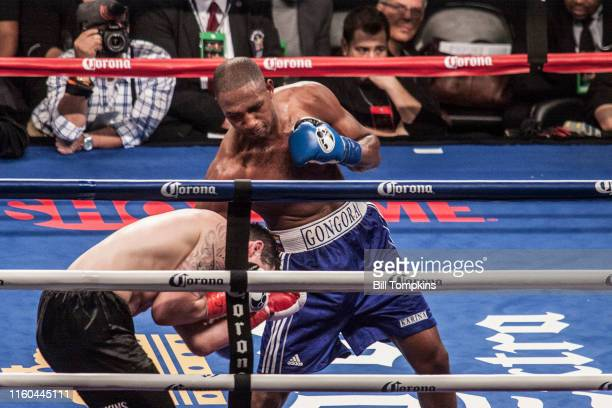 January 16: MANDATORY CREDIT Bill Tompkins/Getty Images Carlos Gongora defeats Derrick Adkins by TKO in their Light Heavyweight fight. Gongoar throws...