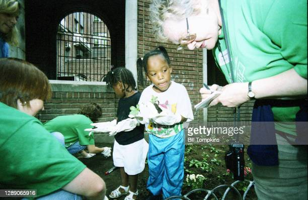 September 21: MANDATORY CREDIT Bill Tompkins/Getty Images Corporate employees plant flowers during an employee community action day on September 21,...