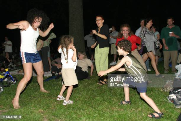 MANDATORY CREDIT Bill Tompkins/Getty Images Crowds dance during Los Lobos performance at Prospect Park on June 16 2004 in Brooklyn