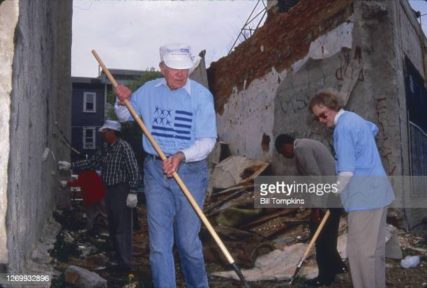 Bill Tompkins/Getty Images Former President Jimmy Carter and former First Lady Rosalyn Carter working with Habitat for Humanity restoring homes May...