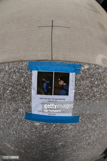 April 20: MANDATORY CREDIT Bill Tompkins/Getty Images Grafitti showing crosses and a survellance photo of the suspected vandal photographed on April...