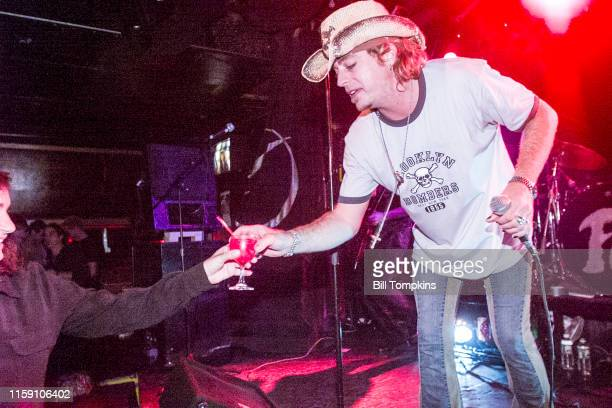 MANDATORY CREDIT Bill Tompkins/Getty Images Leif Garrett accepts a drink form a woman in the audience while performing with his band F8 at club DON...