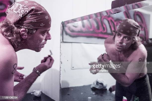 MANDATORY CREDIT Bill Tompkins/Getty Images Leif Garrett shaves and looks at himself in the mirror prior ot performing with his band F8 at club DON...