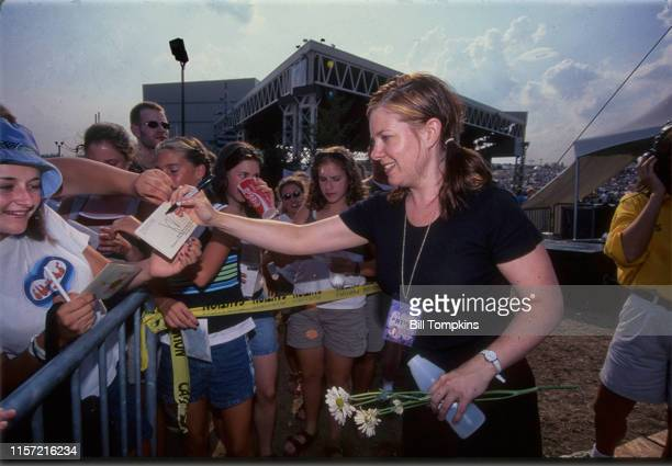 August 9: MANDATORY CREDIT Bill Tompkins/Getty Images Lilith Fair organizer Nathalie Merchant signing autographs backstage August 9, 1999 in New York...