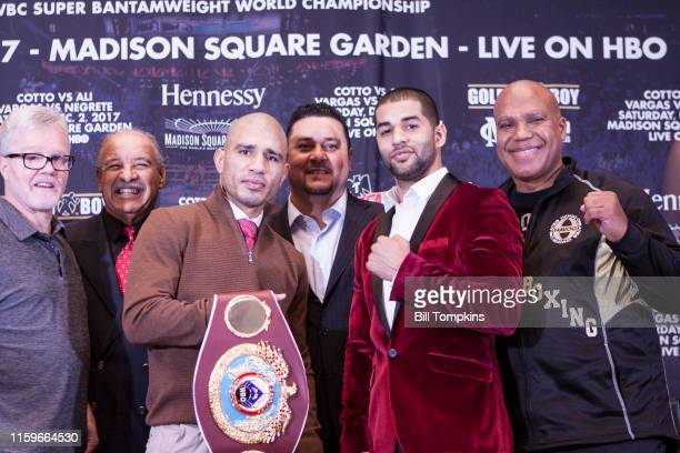 November 29: MANDATORY CREDIT Bill Tompkins/Getty Images Miguel Cotto and Sadam Ali pose at the press conference prior to their Junior Middleweight...