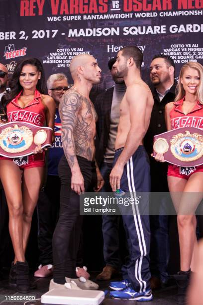December 1: MANDATORY CREDIT Bill Tompkins/Getty Images Miguel Cotto and Sadam Ali pose at the press conference prior to their Junior Middleweight...