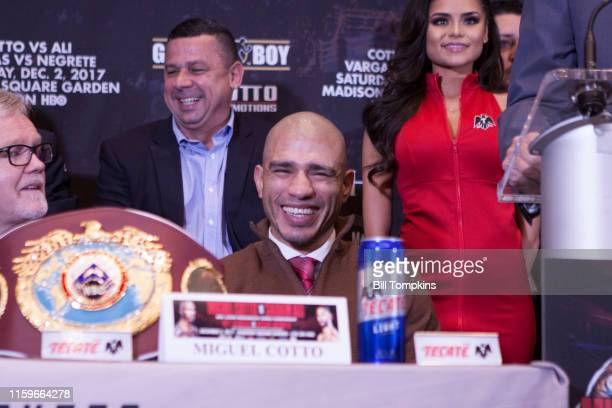 November 29: MANDATORY CREDIT Bill Tompkins/Getty Images Miguel Cotto laughs during the press conference prior ot his Junior Middleweight fight...