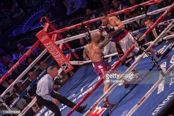 MANDATORY CREDIT Bill Tompkins/Getty Images Miguel Cotto throws a righ at Sergio martinez during their world middleweight boxng match in which Cotto...