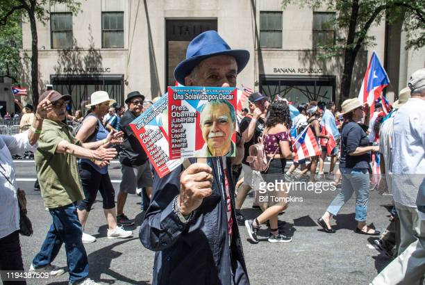 MANDATORY CREDIT Bill Tompkins/Getty Images Protesters supporting Oscar Lopez Rivera during the Puerto Rican Day Parade on June 11 2017 in New York...